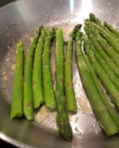 Cooking the asparagus with some olive oil for a minute